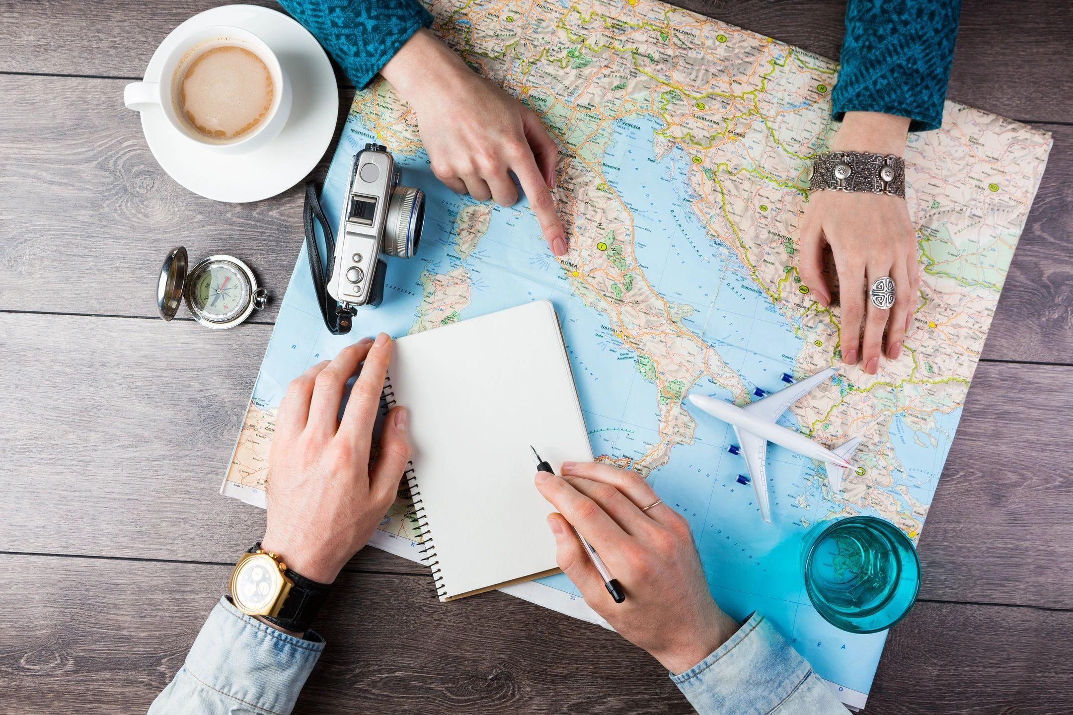 Man and woman looking at a map for places to travel