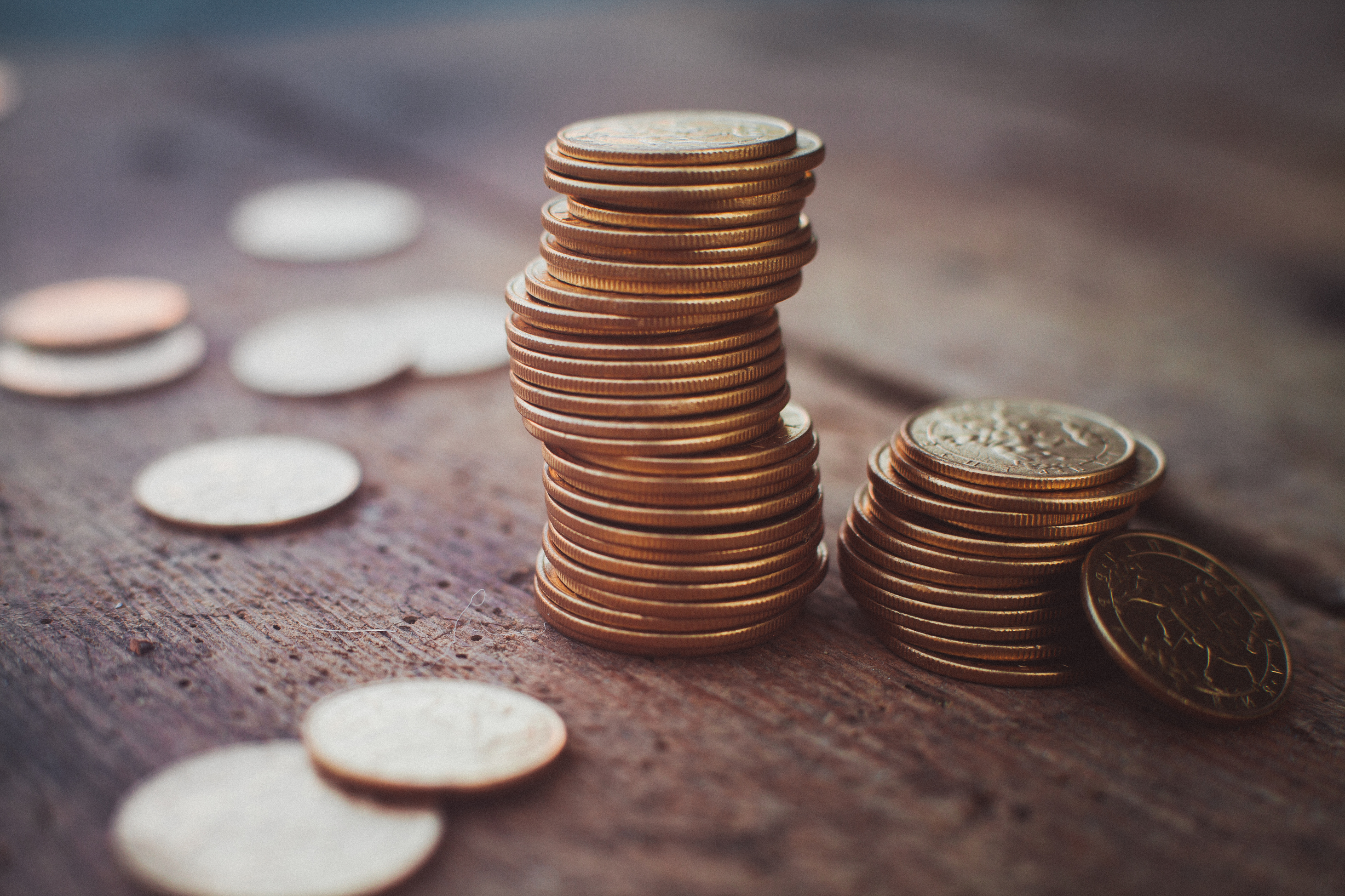 Stack of coins on a wood desk