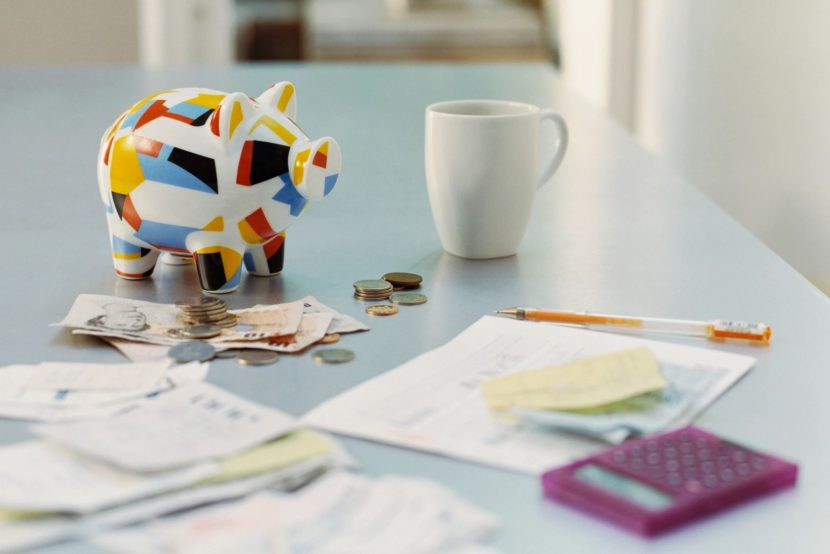A piggy bank and paperwork on a table