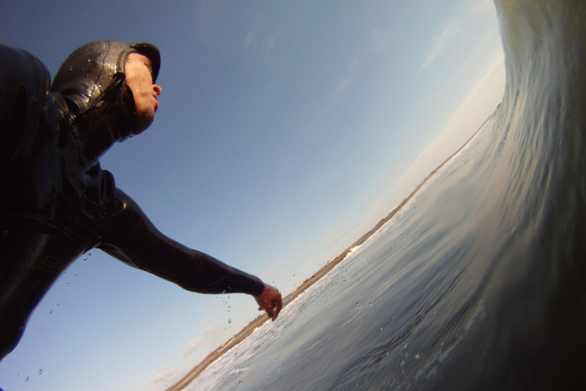 Scott Michie, Branch Manager, surfing in Ocean Shores