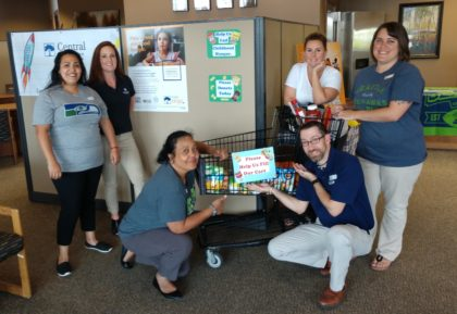 Group photo of Union Gap branch celebrating our August bank-wide food drive